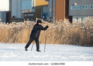 Yakutsk, Republic of Sakha (Yakutia)/Russia-November 12 2017:  elderly asian man skiing on a frozen lake
