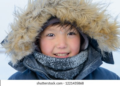 Yakutsk, Republic of Sakha (Yakutia)/Russia-November 13 2016:  Portrait of Yakut boy with frozen eyelashes