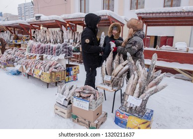 Yakutsk, Republic of Yakutia, Russia. 01.16.2019.The coldest market in the world is in the city of Yakutsk. It sells fresh-frozen fish, meat, berries. The temperature drops to -57 degrees.