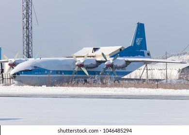 Yakutsk / Russia - 02.28.2015. Yakutsk International Airport. Cargo turboprop plane Antonov 12 (AN-12) under the snow.