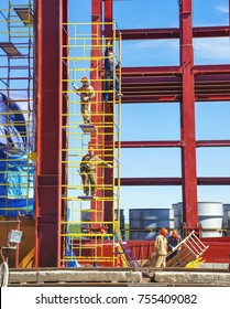 YAKUTSK, RUSSIA - JUNE 26, 2015: Mounters on scaffolding at the construction site of a power plant