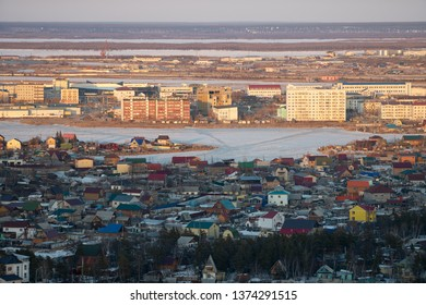 Yakutsk, Yakutia / Russia - April 14 2019: Yakutsk city downtown aerial view from hill at amazing sunset. Aerial view of Yakutsk skyline with Beloe lake in beautiful post sunset