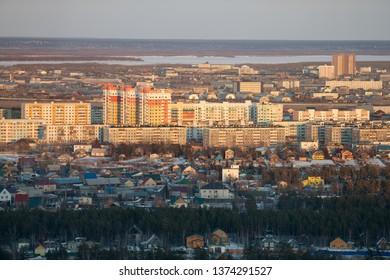 Yakutsk, Yakutia / Russia - April 14 2019: Yakutsk city downtown aerial view from hill at amazing sunset. Sunrise or sunset overlooking to new district of city