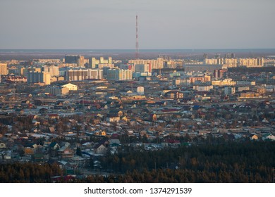 Yakutsk, Yakutia / Russia - April 14 2019: Yakutsk city midtown aerial view from hill at amazing sunset. View from the hill on the city