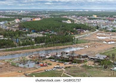 Yakutsk, Yakutia / Russia - June 01 2019: Yakutsk city downtown aerial view from hill.  Aerial view of Yakutsk skyline over the ethnographic complex Chochur Muran, place of rest of citizens