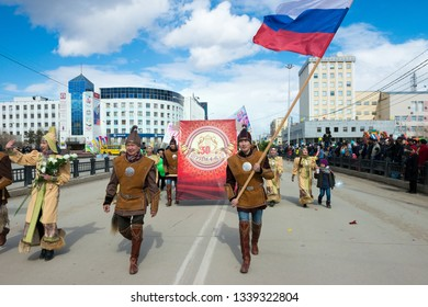 Yakutsk, Yakutia/Russia - May 01 2017: Demonstration of parade participants in the centre Yakutsk city on the International Workers' Day. Yakut youth in national costumes