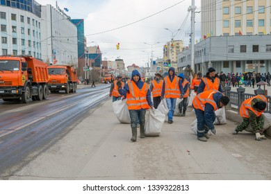 Yakutsk, Yakutia/Russia - May 01 2017: Street cleaning after Demonstration of parade participants in the centre Yakutsk city on the International Workers' Day