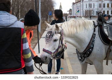 Yakutsk, Yakutia/Russia - May 01 2017: beautiful white horse with ornaments Yakut patterns, dressed up for the occasion of the Labor Day in the centre Yakutsk city on the International Workers' Day