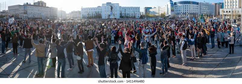 Yakutsk, Yakutia/Russia- May 21 2019: Celebration of a significant event - the inclusion of eight districts of Yakutia in the Arctic zone of Russia. Panoramic photo of large crowd of people