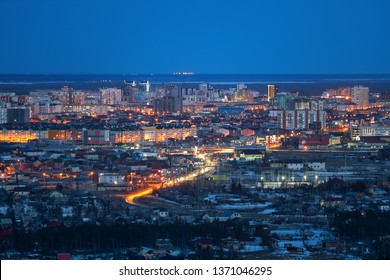 Yakutsk, Yakutia/Russia-April 14 2019: Aerial view of night city view with night sky, natural winter night view in Yakutsk