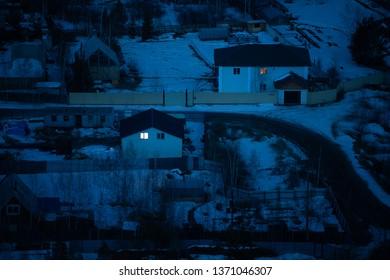 Yakutsk, Yakutia/Russia-April 14 2019: Aerial view of houses with road, natural winter night view in Yakutsk