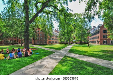 YALE UNIVERSITY, NEW HAVEN, CONNECTICUT, USA - CIRCA 2015: Old campus quad with paved walkways passing diagonally through the grass lawn. Student housing dorms and faculty buildings surround the quad.