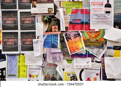 YALE UNIVERSITY, NEW HAVEN, CONNECTICUT, USA - OCTOBER 2017: A notice board on the Yale old campus filled with signs regarding student events
