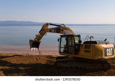 Yalova / Istanbul - May 3, 2019 ; demolition of a hot dog stand at the beach. Hydraulic Crawler Excavator Cat working at a ground