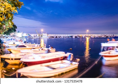 Yalova, Marmara / Turkey - August 25, 2018: Marina and fishermen shelter during a full moon night in summer by the side of shoreline nearby the center of the town