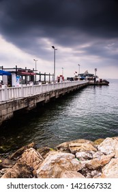 Yalova, Marmara / Turkey - June 11, 2019: Ferry port and summer establishment around the central square park by the seaside of a holiday and summer vacation town