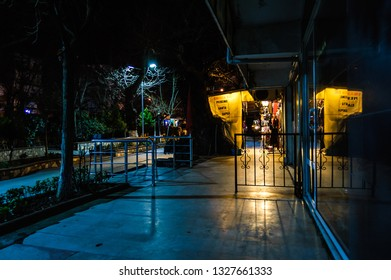 Yalova, Marmara / Turkey - March 2, 2019: Streets of small summer and holiday vacation town in cold calm winter night with peaceful empty environment