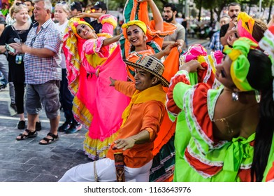 Yalova, Turkey - July 5, 2018: Amateur folk dancers from Argentina, Colombia, Georgia, Serbia, Montenegro and Macedonia in the street of a summer vacation area for a charity event without press