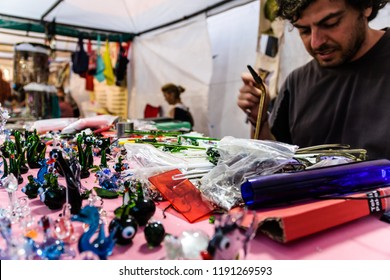 Yalova, Turkey - July 6, 2017: Glass artist working and creating beautiful ornaments and figurines during Turkish cultural fair took place on a small town named Cinarcik located in Marmara region