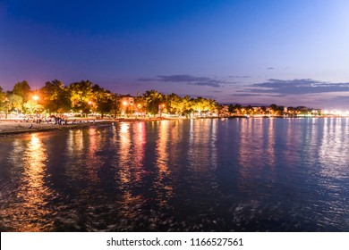 Yalova, Turkey - June 17, 2018: Atmospheric cityscape scenery with colorful artificial lights of buildings in warm summer evening environment