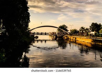Yalova, Turkey - June 17, 2018: Modern landmark named Lover's Bridge in center square of the city during a hot summer evening