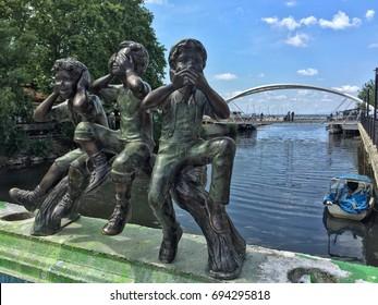 YALOVA, TURKEY - JUNE 2017; Small statues by river in the city centre of Yalova in Turkey
