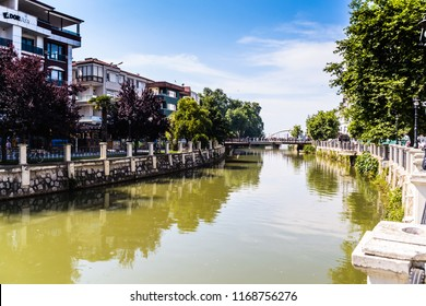 Yalova, Turkey - June 5, 2018: Channel environment going through the town to the sea with natural environment and buildings around it during a bright and warm summer day