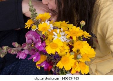 Yalova / Turkey - May 2, 2019 ; celebrate the victim feast of the elders on the religious holidays.happy mother and teachers day.kiss the mum hand.woman and kid hold the yellow daisy.