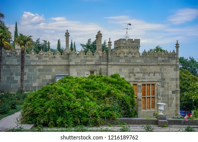 Yalta, Crimea - June 22, 2015: People walk around the yard Vorontsov Palace, located in the middle of a green Park.