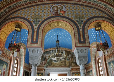 YALTA, CRIMEA - May 05, 2017 Elegant Pillars with Arches and Colorful Vaults of Holy Cross Church. Interior view of the Home Church of Romanovs in Livadia.