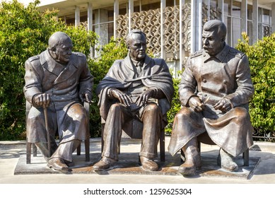 Yalta, Crimea - May 17, 2016: Sculpture of Churchill, Roosevelt and Stalin in Livadia Palace, Crimea, Russia. Statues by Zurab Tsereteli in summer. The famous Conference was held here in 1945.