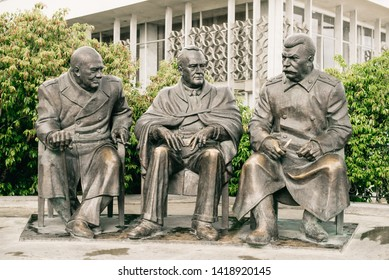 """Yalta. Crimea. Russia - August 31, 2017: Monument to the Leaders of the """"Big Three"""" - Joseph Stalin, Franklin Roosevelt and Winston Churchill in Livadia, Yalta."""