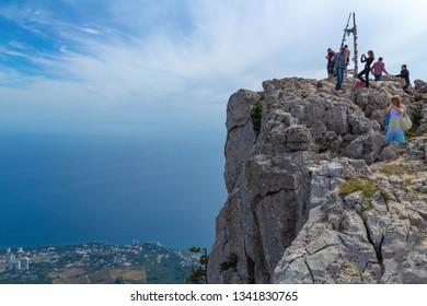 Yalta, Crimea - September 13, 2012: Tourists on the top of Mount Ai-Petri view and photograph a beautiful landscape