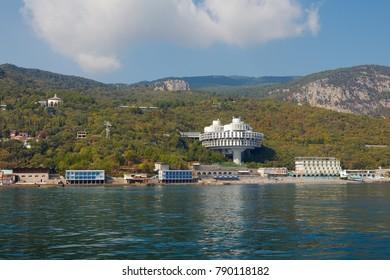 YALTA, CRIMEA - SEPTEMBER 29, 2012: Druzhba Sanatorium on the shore, masterpiece of Russian modernist architecture by Igor Vasilevsky
