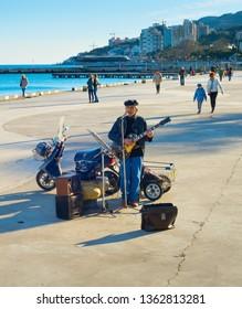 YALTA, CRIMEA, UKRAINE - APRIL 03, 2018: Street musician at Yalta promenade in sunny day. Yalta is the most famous tourist destination in Crimea