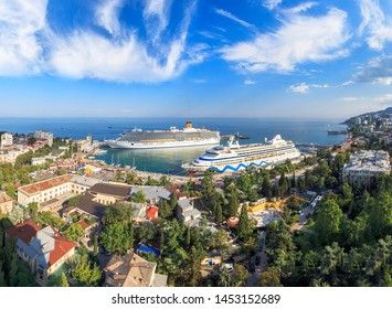 YALTA, CRIMEA, UKRAINE - JULY 7: Costa Mediterranea and Aida cruise liners in the port of Yalta on July 7, 2013. A bright sunny day with a panorama of the city. It was constructed in Helsinki in 2003.