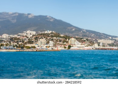 YALTA - February 21, 2015: Beautiful view on embankment of Yalta. Sunny day. Tilt-shift. Yalta resort town in the southern Crimea. Russia. Ukraine
