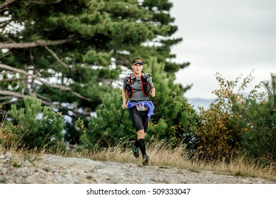 Yalta, Russia - October 5, 2016: runner skyrunner with nordic hiking running mountain landscape during Crimea mountain marathon