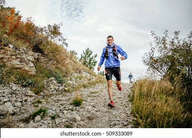 Yalta, Russia - October 5, 2016: male runner of middle age runs on a mountain trail during Crimea mountain marathon
