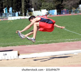 YALTA, UKRAINE - APRIL 25: Grebenuk Viktor compete in the long jump competition for boys age 16-17 on Ukrainian Junior Track and Field Championships on April 25, 2012 in Yalta, Ukraine.