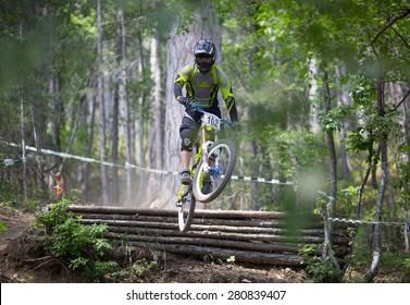 "YALTA, UKRAINE - MAY 23: BOCHANSKIY Evgeniy on the competition of the mountain bike ""Freerate DH 2015"" on May 23, 2015 in Yalta, Ukraine"