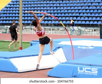YALTA, UKRAINE - MAY 24: Parlak Demet from Turkey competes in pole vault competition for girls +17 on the international athletic meet Ukraine - Turkey - Belarus on May 24, 2012 in Yalta, Ukraine.