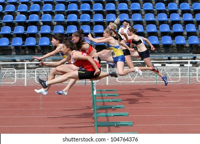 Yalta, Ukraine - May 24:  Unidentified girls age 17 at the hurdles race on the international athletic meet between Ukraine, Turkey, Belarus on May 24, 2012 in Yalta, Ukraine .