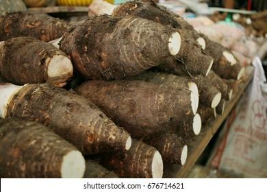 Yam, Inhame, Cara. Colocasia esculenta on local market counter for sale