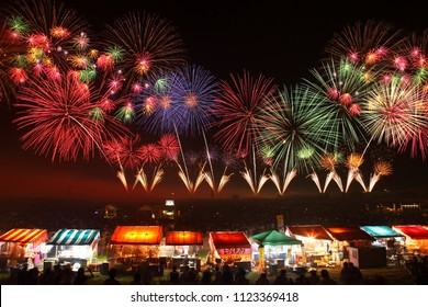 Yamagata, Japan - August 2, 2014: Sakata Fireworks Show. Dynamic fireworks show with 12,000 fireworks launched including 15 Shakudama fireworks launched simultaneously.