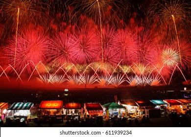 Yamagata, Japan - August 2, 2014: Sakata Fireworks Show. Dynamic fireworks show with 12,000 fireworks launched including 15 Shakudama fireworks launched simultaneously.