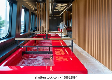 YAMAGATA,JAPAN - APRIL 17,2016: Interior of Toreiyu Tsubasa, The first ever sightseeing high-speed train. This is safflower-colored footbaths, sofa, wooden louvers and Yamagata fruit motifs ceiling.