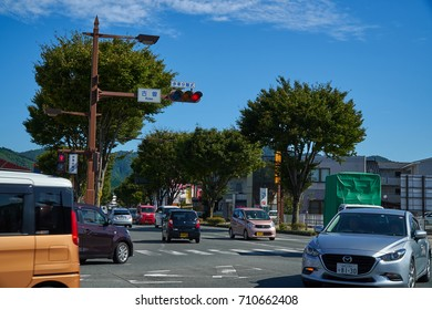 Yamaguchi City, Japan - August 31, 2017: The junction road near the Yamaguchi University. The vecihle moving following the traffic lights' rule.