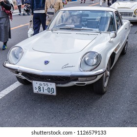YAMAGUCHI, JAPAN - APRIL 8, 2018: A front angle view of a classic, vintage Mazda Cosmo sports car from the sixties on a street in Japan.