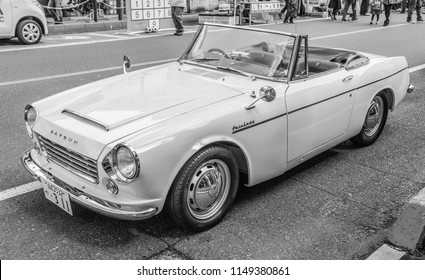 YAMAGUCHI, JAPAN - APRIL 8, 2018: A side angle view, black and white photo of a classic Nissan Datsun Fairlady convertible sports car.